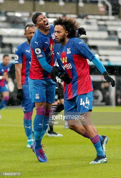 Jairo Riedewald of Crystal Palace celebrates with team mate Patrick van Aanholt after scoring their side's first goal during the Premier League match...