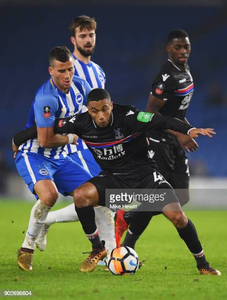 Jairo Riedewald of Crystal Palace tangles with Tomer Hemed of Brighton and Hove Albion during The Emirates FA Cup Third Round match between Brighton...