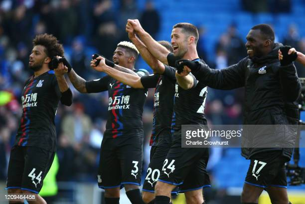 Jairo Riedewald Patrick van Aanholt Cenk Tosun Gary Cahill and Christian Benteke of Crystal Palace celebrate following their sides victory after the...