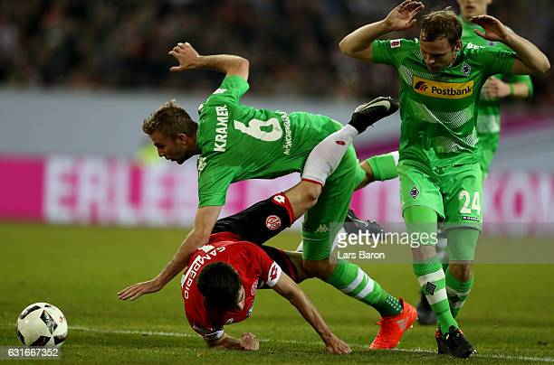Jairo Samperio of Mainz is challenged by Christoph Kramer of Moenchengladbach and Tony Jantschke of Moenchengladbach during the Telekom Cup 2017...