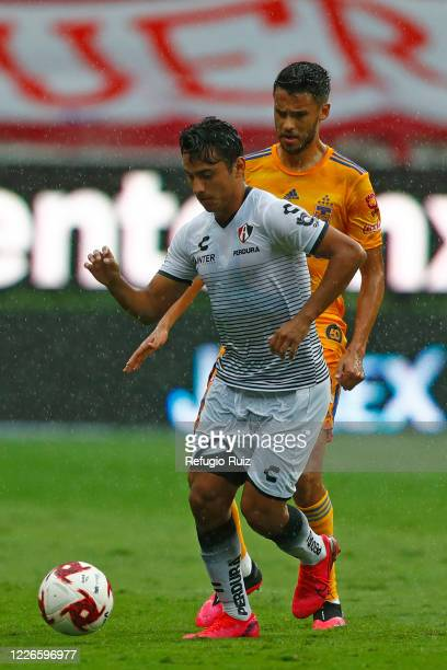 Jairo Torres of Atlas fights for the ball with Diego Reyes of Tigres during the match between Atlas and Tigres UANL as part of the friendship...