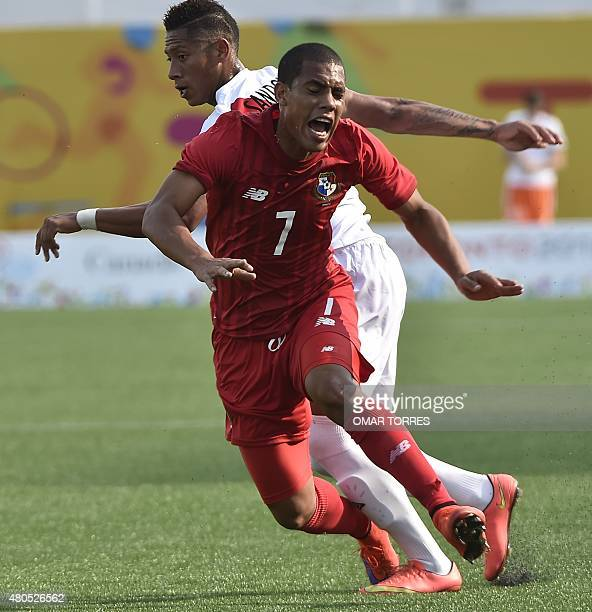 Jairon Jimenez of Panama vies for the ball with Juan Morales of Peru during a first round group A football match of the Pan American Games in...