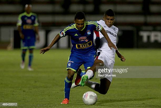 Jairsinho Gonzales of Sporting Cristal struggles for the ball with Wilder Cartagena of San Martin during a match between San Martin and Sporting...