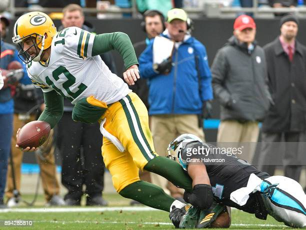Jairus Byrd of the Carolina Panthers tackles Aaron Rodgers of the Green Bay Packers during their game at Bank of America Stadium on December 17 2017...
