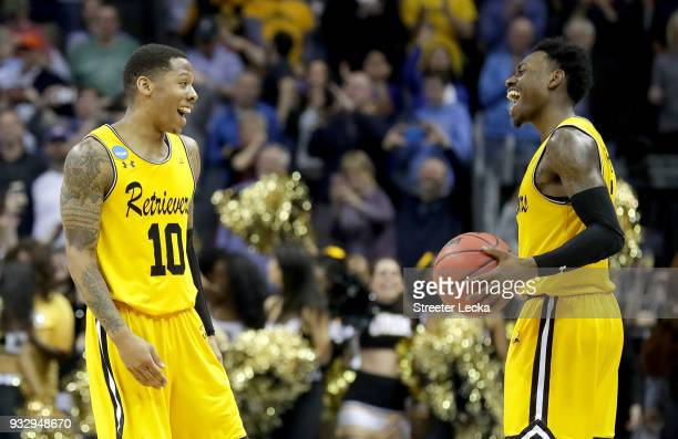 Jairus Lyles and teammate Jourdan Grant of the UMBC Retrievers react to their 7454 victory over the Virginia Cavaliers during the first round of the...