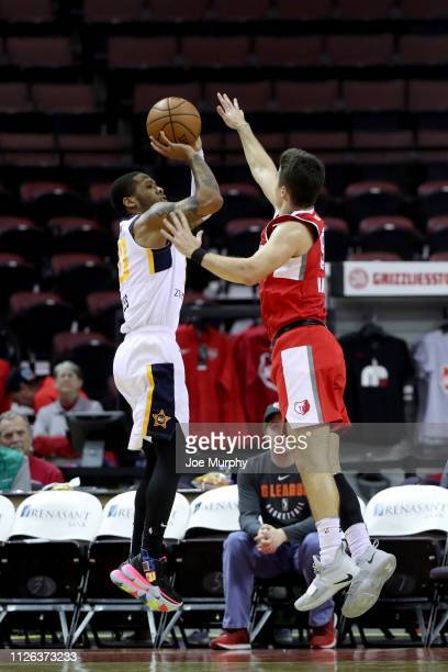 Jairus Lyles of the Salt Lake City Stars shoots a jump shot against Dusty Hannahs of the Memphis Hustle during an NBA GLeague game on February 20...