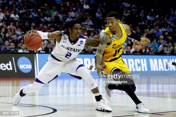 Jairus Lyles of the UMBC Retrievers defends Cartier Diarra of the Kansas State Wildcats during the second round of the 2018 NCAA Men's Basketball...