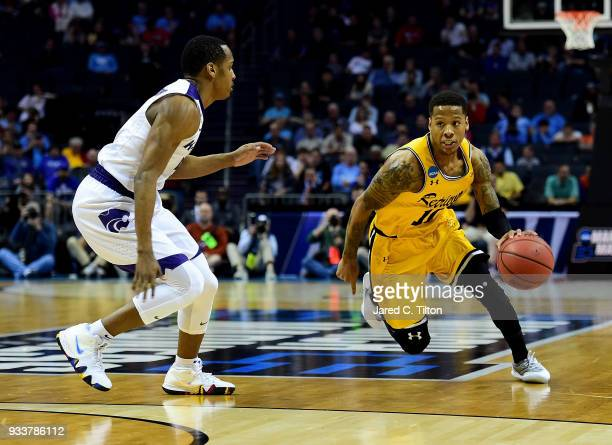 Jairus Lyles of the UMBC Retrievers drives to the basket against Barry Brown of the Kansas State Wildcats during the second round of the 2018 NCAA...