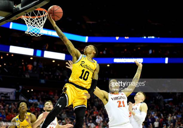Jairus Lyles of the UMBC Retrievers drives to the basket against the Virginia Cavaliers during the first round of the 2018 NCAA Men's Basketball...