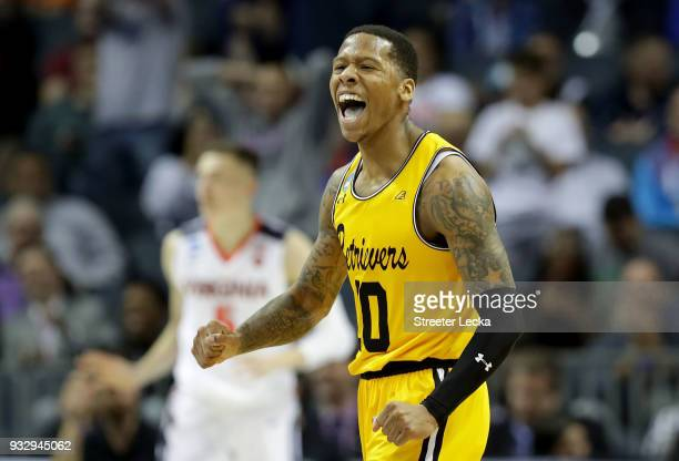 Jairus Lyles of the UMBC Retrievers reacts after a score against the Virginia Cavaliers during the first round of the 2018 NCAA Men's Basketball...