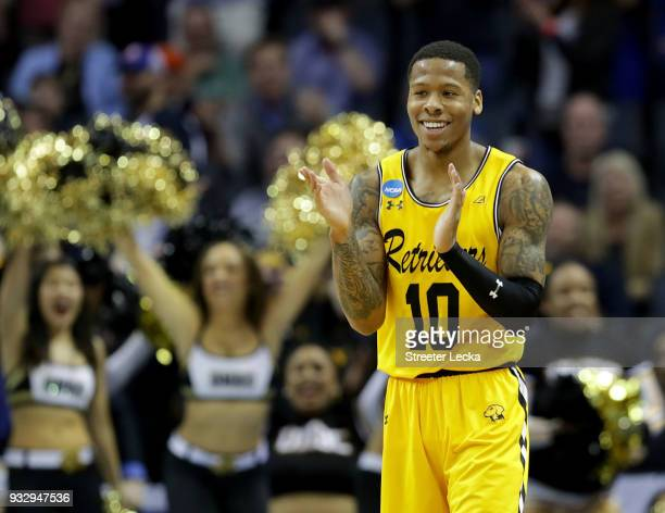 Jairus Lyles of the UMBC Retrievers reacts to their upset of the Virginia Cavaliers 7454 during the first round of the 2018 NCAA Men's Basketball...