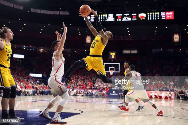 Jairus Lyles of the UMBC Retrievers shoots against Alex Barcello of the Arizona Wildcats during the first half of the college basketball game at...