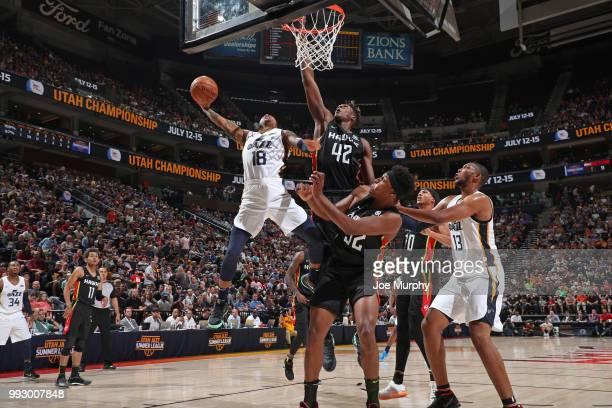 Jairus Lyles of the Utah Jazz shoots a layup over Alpha Kaba of the Atlanta Hawks on July 5 2018 at Vivint Smart Home Arena in Salt Lake City Utah...
