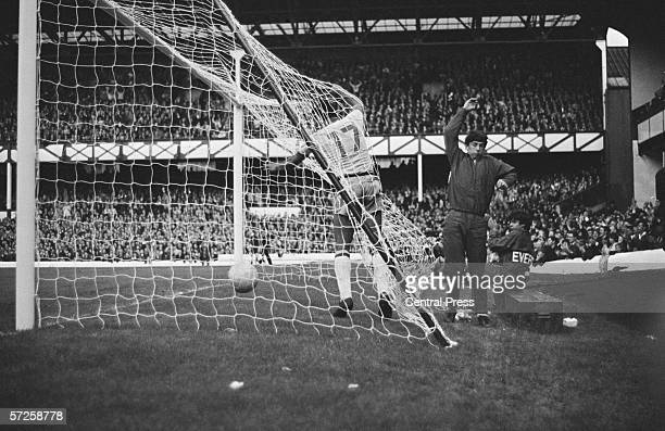 Jairzinho crashes into the net after Brazil score their one goal in the Group C fixture with Portugal during the 1966 World Cup in England 19th July...