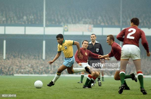 Jairzinho of Brazil moves through the Hungarian defence watched by referee Ken Dagnall during the FIFA World Cup match at Goodison Park in Liverpool...