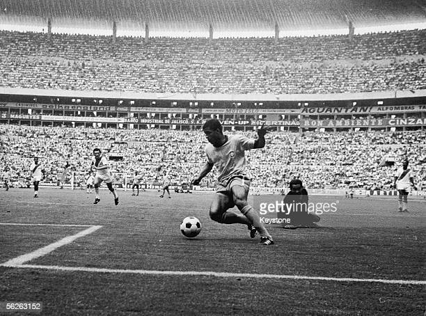 Jairzinho of Brazil rounds Luis Rubinos of Peru to score the fourth goal during the FIFA World Cup quarterfinals match played at the Estadio Jalisco...