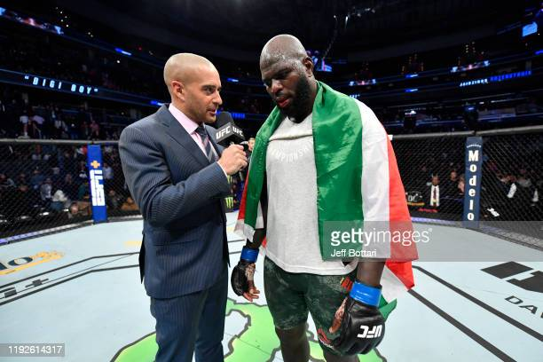 Jairzinho Rozenstruik of Suriname is interviewed by Jon Anik after his KO victory over Alistair Overeem of Netherlands in their heavyweight bout...