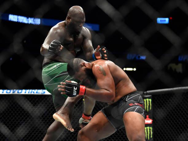 Jairzinho Rozenstruik of Suriname knees Curtis Blaydes in their heavyweight fight during the UFC 266 event on September 25, 2021 in Las Vegas, Nevada.