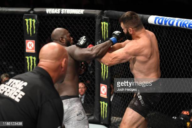 Jairzinho Rozenstruik of Suriname punches Andrei Arlovski in their heavyweight bout during the UFC 244 event at Madison Square Garden on November 02...