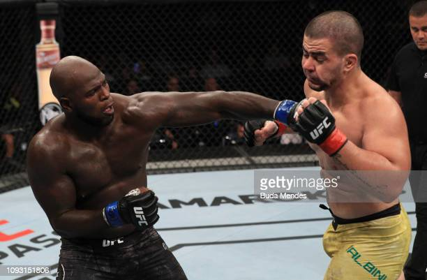 Jairzinho Rozenstruik of Suriname punches Junior Albini of Brazil in their heavyweight fight during the UFC Fight Night event at CFO Centro de...