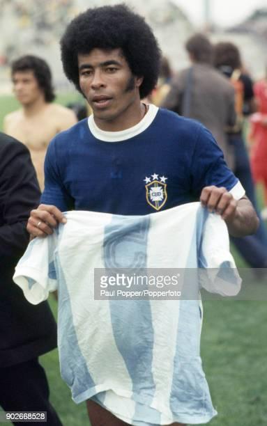 Jairzinho who scored Brazil's winning goal leaves the field with an Argentina shirt as a souvenir following the FIFA World Cup match between...