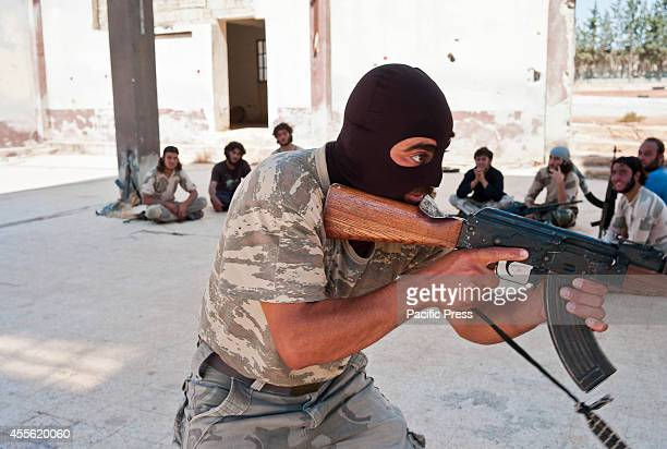 Jaish alMujahideen new recruits train in an evacuated ISIS training camp in Northern Aleppo countryside They are preparing to fight ISIS troops in...