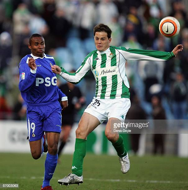 Jaja Coelho of Getafe is challenged by Nano of Real Betis during a Primera Liga match between Getafe and Real Betis at the Coliseum Alfonso Perez...