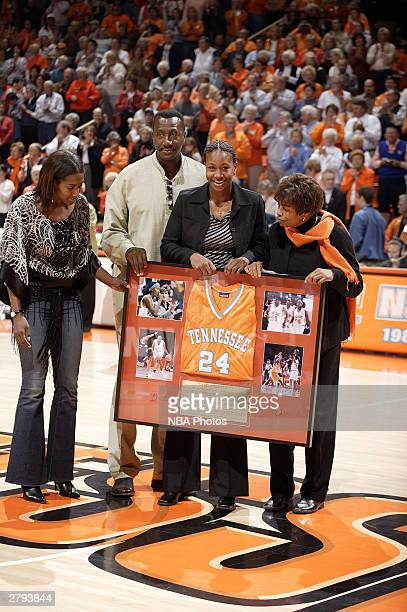 Jaja Harvey Tamika Catchings and Mrs Catchings during a halftime ceremony retiring Tamika Catchings college jersey December 7 2003 at ThompsonBoling...