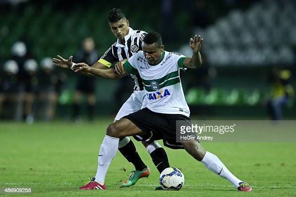 Jaja of Coritiba competes for the ball with Emerson of Santos during the match between Coritiba and Santos for the Brazilian Series A 2014 at Couto...