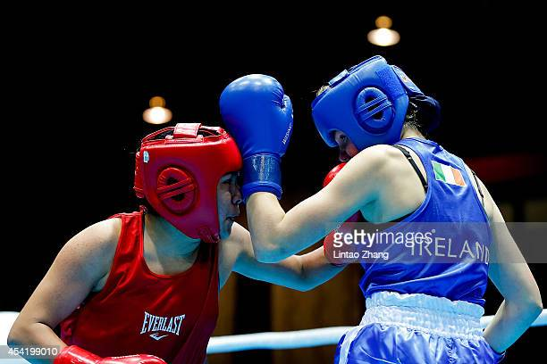 Jajaira Gonzalez of United States fights against Ciara Ginty of Ireland during the Women's Light Final on day ten of the Nanjing 2014 Summer Youth...
