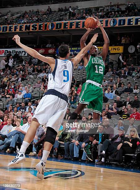 JaJuan Johnson of the Boston Celtics shoots a jumper against Yi Jianlian of the Dallas Mavericks on February 20 2012 at the American Airlines Center...