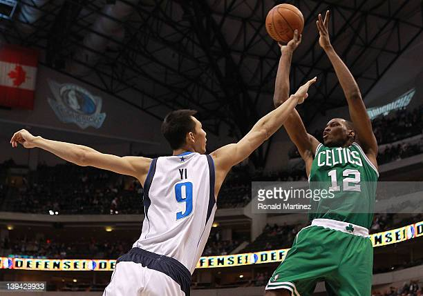 JaJuan Johnson of the Boston Celtics takes a shot against Yi Jianlian of the Dallas Mavericks at American Airlines Center on February 20 2012 in...