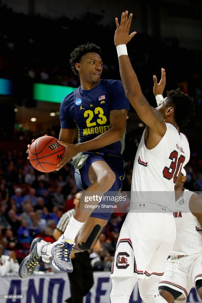 Jajuan Johnson #23 of the Marquette Golden Eagles passes against Chris Silva #30 of the South Carolina Gamecocks in the first half during the first round of the 2017 NCAA Men's Basketball Tournament at Bon Secours Wellness Arena on March 17, 2017 in Greenville, South Carolina.