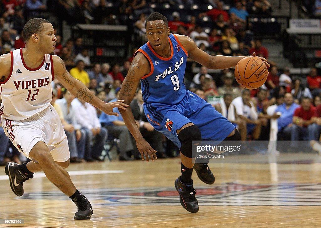 JaJuan Smith #9 of theTulsa 66ers dribbles against Will Conroy #12 of the Rio Grande Valley Vipers in Game Two of the 2010 NBA D-League Finals at the State Farm Arena on April 27, 2010 in Hidalgo, Texas. The Valley Vipers won 94-91 to claim the D-League Championship.