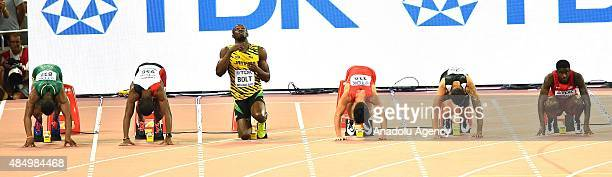 Jak Ali Harvey of Turkey and Usain Bolt of Jamaica prepare for the men's 100 metres semifinal during the '15t IAAF World Athletics Championships...