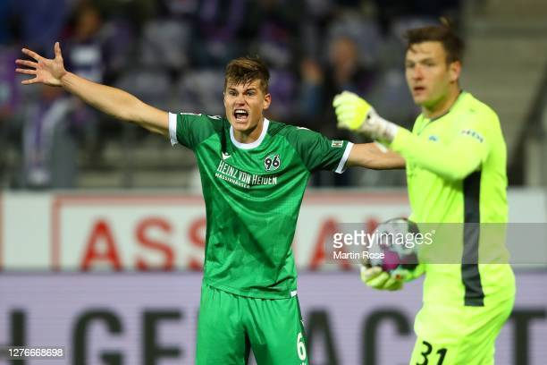 Jaka Bijol of Hannover reacts with his keeper Michael Esser during the Second Bundesliga match between VfL Osnabrück and Hannover 96 at Stadion an...