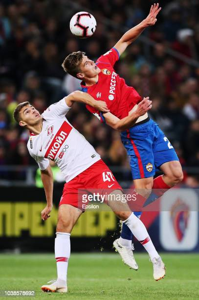 Jaka Bijol of PFC CSKA Moscow vies for the ball with Roman Zobnin of FC Spartak Moscow during the Russian Premier League match between PFC CSKA...