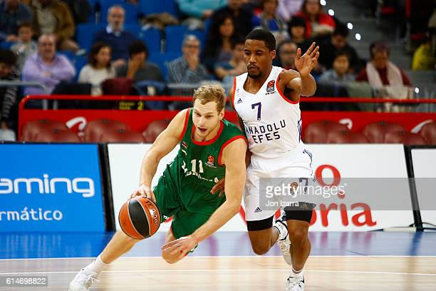 Jaka Blazic #11 of Baskonia Vitoria Gasteiz competes with Bryce Cotton #7 of Anadolu Efes Istanbul during the 2016/2017 Turkish Airlines EuroLeague...