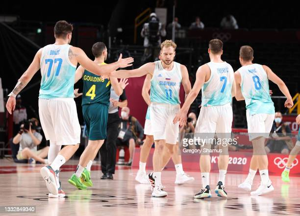 Jaka Blazic of Team Slovenia high-fives teammate Luka Doncic during the second half of the Men's Basketball Bronze medal game between Team Slovenia...