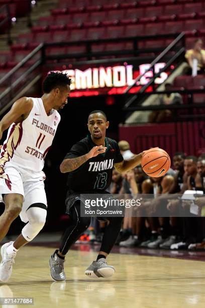 Jakari Bush guard Thomas University Night Hawks advances the basketball against Braian AngolaRodas guard Florida State University Seminoles in an...