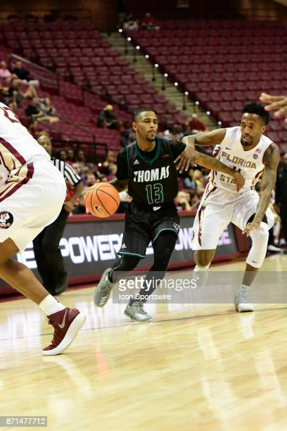Jakari Bush guard Thomas University Night Hawks attemts to push past Braian AngolaRodas guard Florida State University Seminoles in an exhibition...