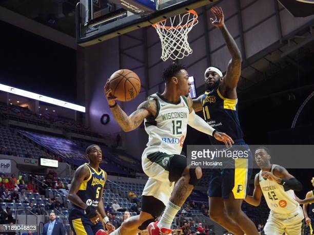 JaKarr Sampson of the Fort Wayne Mad Ants handles the ball against Rayjon Tucker of the Wisconsin Herd on December 16 2019 at Memorial Coliseum in...