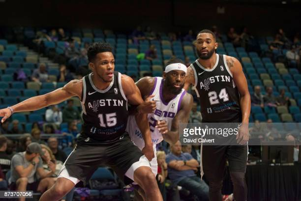 JaKarr Sampson of the Reno Bighorns boxes out against Jason Blossomgame and Darrun Hilliard of the Austin Spurs during an NBA GLeague game on Nov 10...