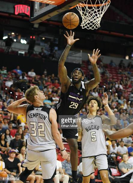 JaKarr Sampson of the Sacramento Kings is fouled by Tim Kempton of the Milwaukee Bucks as DJ Wilson of the Bucks looks on during the 2017 Summer...