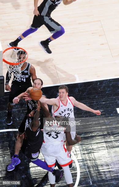 JaKarr Sampson of the Sacramento Kings puts up a shot against Pascal Siakam and Jakob Poeltl of the Toronto Raptors on December 10 2017 at Golden 1...