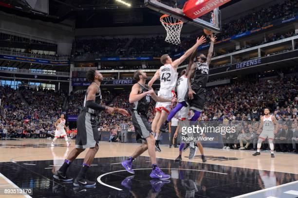 JaKarr Sampson of the Sacramento Kings rebounds against Jakob Poeltl of the Toronto Raptors on December 10 2017 at Golden 1 Center in Sacramento...