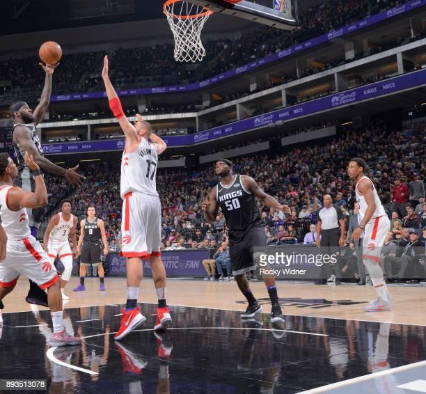 JaKarr Sampson of the Sacramento Kings shoots against Jonas Valanciunas of the Toronto Raptors on December 10 2017 at Golden 1 Center in Sacramento...