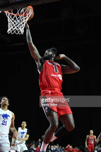 JaKarr Simpson of the Windy City Bulls goes to the basket past Rashad Vaughn and Zhaire Smith of the Delaware Blue Coats during an NBA GLeague game...