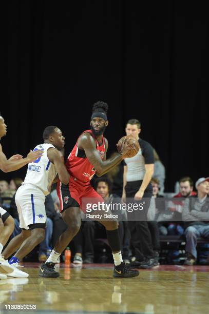 JaKarr Simpson of the Windy City Bulls looks to pass while defended by Jared Brownridge of the Delaware Blue Coats during an NBA GLeague game on...