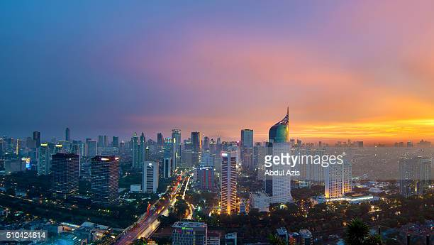 jakarta cityscape epic sunset - indonesia stock photos and pictures